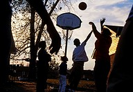Family playing basket, Friars Point, Mississippi, USA