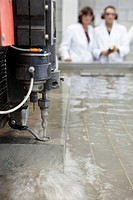Researchers using abrasive waterjet technology cutting machine for metals and nonmetal materials, Fatronik-Tecnalia, Research and Technology Center, D...