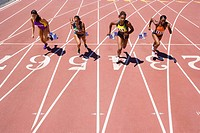 Female athletes running or race track
