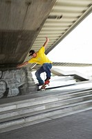 male teenager with skateboard, jumping