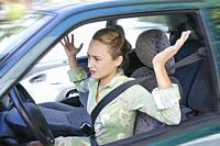 Young woman gesturing in a car