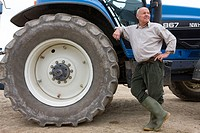 Farmer leaning on tractor