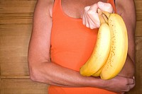 Close up of woman holding banana bunch