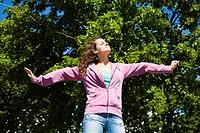 A teenage girl is enjoying a warm summer day.