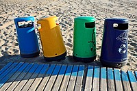 Front view of garbage containers on the beach in Valencia