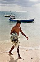 Man carrying fishing nets on beach, Lembongan, Bali, Indonesia