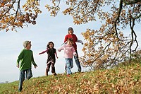 Four children running in park