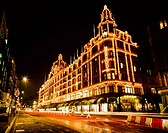 Harrods with Christmas lights at night, London, UK