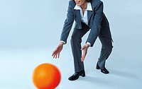 Businesswoman catching ball
