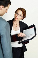 Businesswoman explaining something from her documents