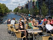 Outdoor cafe by canal, Amsterdam, The Netherlands