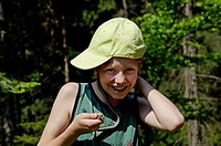 Eleven year old boy holding a Grass Snake (Natrix natrix) around his neck