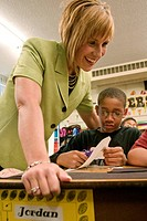 Jamie Otto, a fifth grade teacher at Robinwood Elementary School, helps Jordan Waters during class.  She has been selected the Ferguson_Florissant Sch...