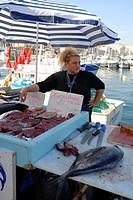 Fish sales woman at the old harbour, Marseilles, Provence-Alpes-Cote d'Azur, France