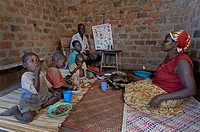 UGANDA  In the home of Najjemba Teopista, Caritas Lugazi agricultural field animator, Kasaayi village, Kayunga District  Family eating breakfast