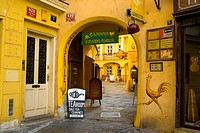 Entrance to a courtyard with a tearoom and an art shop in old town Prague Czech Republic Europe