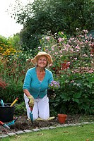 Elder woman working in garden