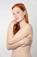 Young redhaired woman topless