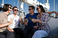 Friends drinking wine on a boat