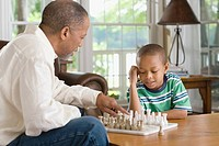 A grandfather and grandson playing chess
