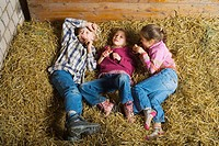 Children lying in a barn