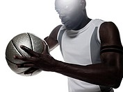 A young man holding basketball
