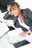 Laughing woman with laptop