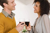 A man and woman having red wine