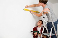 A gay couple doing diy together