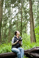 Woman in forest with notebook