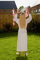 Woman putting lingerie in washing line
