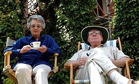 Close_up of a senior couple sitting in chairs