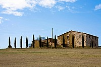 With cypresses Cupressus lined country house in the valley Val d´Orcia Crete Tuscany Italy