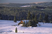 Winter landscape with view over plateau, solitary house in the background, Filipova Hut, Sumava, Bohemian Forest, Czech Republic