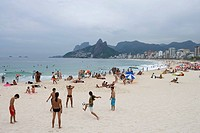 Young men playing beach soccer on Ipanema Beach, Ipanema, Rio de Janeiro, Brazil, South America