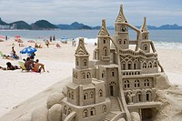 Building sand castles with nativity scene on Copacabana Beach, Copacabana, Rio de Janeiro, Brazil, South America