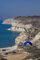 Paraglider over the steep rocky coast, Kourion, South Cyprus, Cyprus