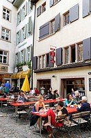 People sitting in a pavement cafe at Andreasplatz, Basel, Switzerland