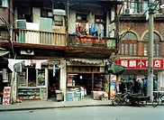 Men playing Mahjong, Urban development, Longtang houses and small shops, Emei Lu, Shanghai, China