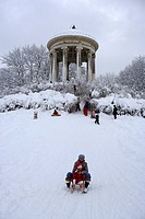 People sledging beneath the Monopteros temple at the English Garden, Munich, Bavaria, Germany