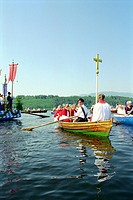 People rowing during a procession on the lake Staffelsee, Murnau, Bavaria, Germany