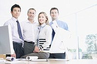 Businesspeople smiling at desk