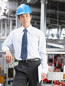 Businessman wearing hard_hat in warehouse