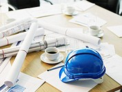 Table with hard_hat and blueprints