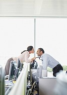 Businesswoman kissing co_worker in office