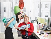 Businesswoman giving birthday gift to co_worker