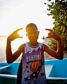 boy flexing in sunset light, dominican republic