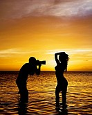 man shooting nude model in sunset