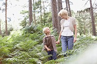 Mother and son walking in woods