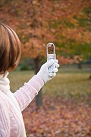 Woman taking photograph with cell phone